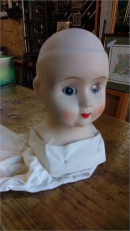 Ceramic dolls head with stitched in cotton tube