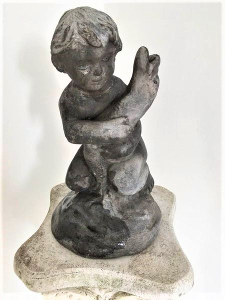 Edwardian Cast Lead Pond Ornament of a Putti Holding a Fish.
