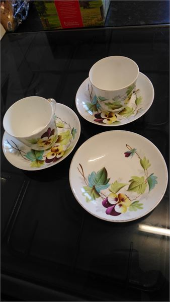 A pair of vintage cups and saucers floral design